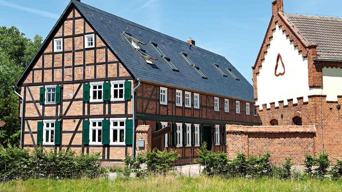 Renovated half-timbered house with garden and outbuilding