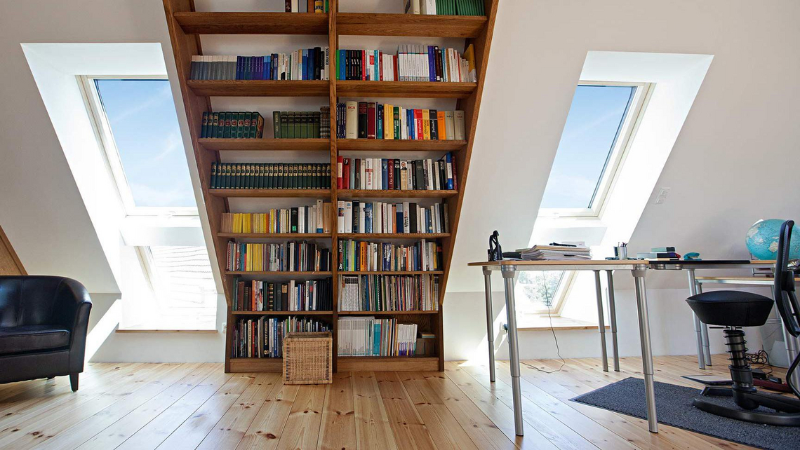 Bookshelf in an attic apartment with roof window in tandem installation method